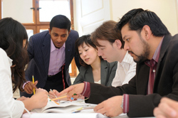 International students studying around a table